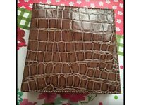 Brown snake skin effect note book has been used once. (Can post)