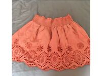 Miss Selfridges little orange skirt