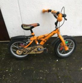 Boys huffy dinosaur bike 14 in wheel