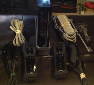 Nintendo Wii With 2 Controllers/2 Nunchucks and 6 Games
