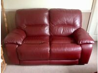 2 piece burgundy leather suite with 2 electric recliners