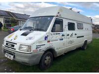 Converted camper van: Seats 8, sleeps 4, kitchen, shower, loo, storage & box for wetsuits, roof rack