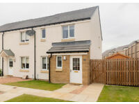 3 bedroom end terrace house with front and rear gardens.