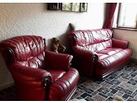 Wine coloured Pendragon leather 3 piece suite with mahogany trim. Excellent condition.