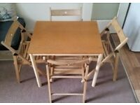 Dining table and folding chairs set