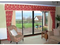 Pair of burgundy brocade curtains. Excellent condition.