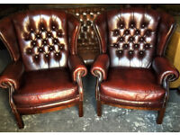 Pair of oxblood leather Chesterfield wing back chairs