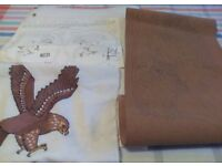 Three different craft items including a wall hanging and two silhouettes, a picture of an eagle.