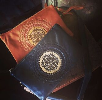 Detailed leather clutch bags