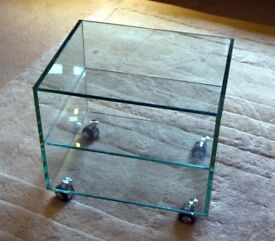 Glass shelving unit on wheels, TV stand/side table