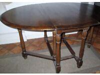 Vintage dark wood drop leaf/extending dining/kitchen table.