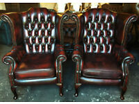 Pair of oxblood leather Chesterfield wingback armchairs