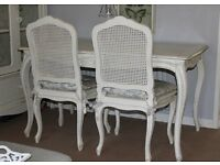 Stunning french style dining table and four chairs. Beautiful carved detail