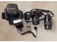 Minolta Dynax 7000i 35mm camera with 35mm - 80mm lens, flash , carry case and tele lens
