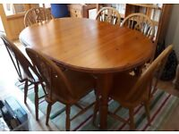 Pine extending dining table and 6 chairs. Used but excellent condition.