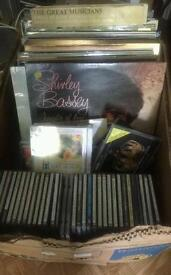 Records, singles and CD's for sale as bulk!