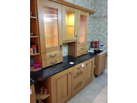 Kitchen dresser/units, with display cabinets and lights.