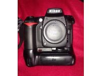 Nikon d90 digital camera and power grip