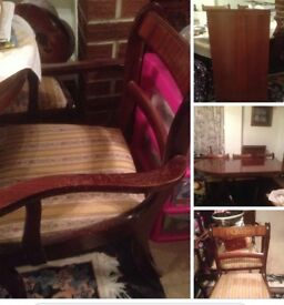 Large dining table with 6 chairs two of which are carver chsirs