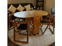 Folding table with four chairs