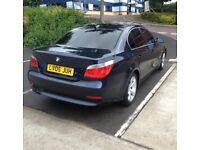 Dark blue 5 series BMW