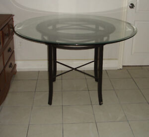 Round glasstop dining table