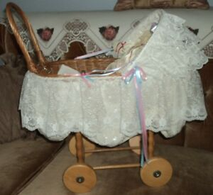Decorative wicker carriage with Porcelain Dolls Sussex