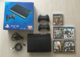 PlayStation 3 super slim 500GB hardly used with 2 controllers and 5 games