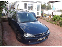 Peugeot 306 Estate. Still a reliable car. Tax and MOT until January 2017.