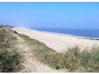 Beachside caravan Norfolk Sleeps 4-6 stunning sea views