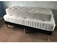 Single bed with mattress and a pullout mattress underneath