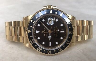 Men's Rolex 16718 yellow gold GMT Master. F Serial. Black Dial.