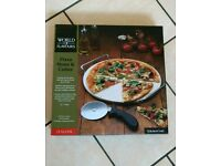 New boxed pizza stone and cutter