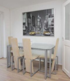 DFS GLASS DINING TABLE AND FOUR CHAIRS