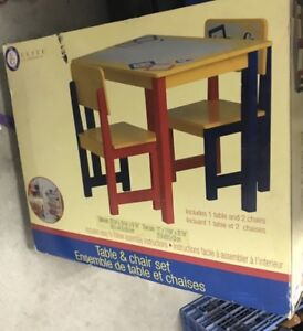 Selling a BRAND NEW IN BOX kids set table with 2 chairs