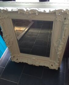 Heavy, great quality detailed mirror.