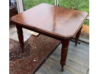 ANTIQUE POLISHED MAHOGANY WIND -OUT EXTENDING TABLE ,CASTERS AND CARVED LEGS