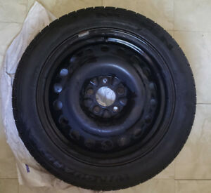Winter tires on steel rims (almost brand new, set of 4)
