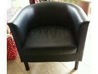 Two black tub chairs