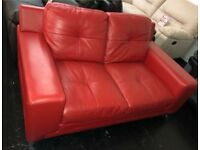DFS Domain red leather 2 seater sofa