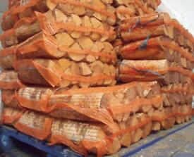 SEASONED QUALITY DRY FIREWOOD LOGS £3.99 PER NET OR 3 NETS FOR £10 OPEN 7 DAYS A WEEK