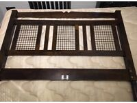 Solid dark wood and metal double bed frame and mattress