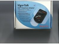 Voip telephone adaptor