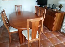 Cherry wood dinning room table with six chairs and sideboard