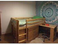 Kid's mid height pine bed by Thukor, with pull out desk and underbed chest of drawers & shelf
