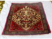 A VINTAGE HAND WOVEN PERSIAN RUG