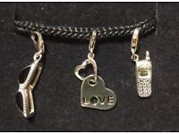 Set Of 3 Clip On Sterling Silver Charms.