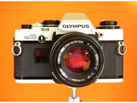 Olympus OM 10 35mm SLR camera with OM Zuiko f1.8 lens, case & strap. Excellent almost new condition.
