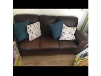 2 x Brown three seater leather sofas