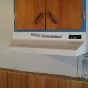 "24"" Electric Range and Range Hood"